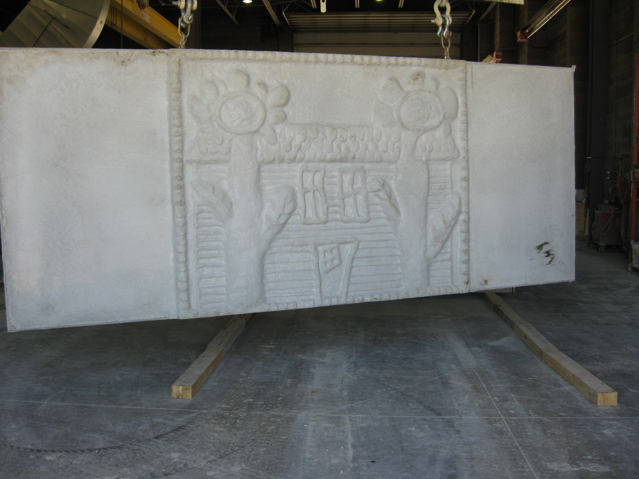 A custom panel created from a child's drawing for a precast noise barrier along I-94 in Milwaukee, WI.