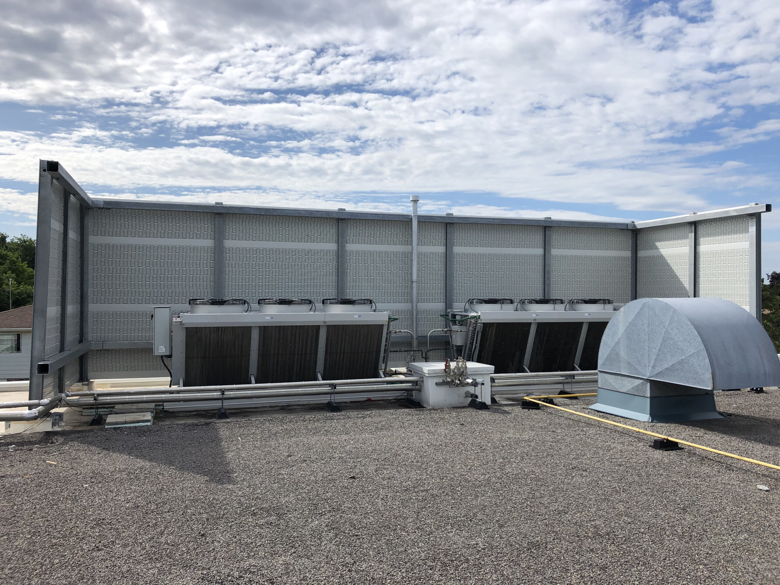PVC post-and-panel rooftop noise barrier system on the roof of a food processing facility in the Greater Toronto Area, ON.