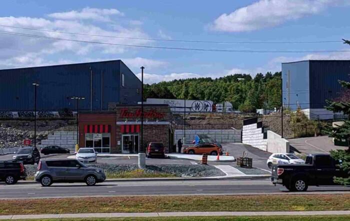The Retain - A - Rock (RAR) Retaining Wall System surrounding a Tim Horton's in Sudbury, ON.