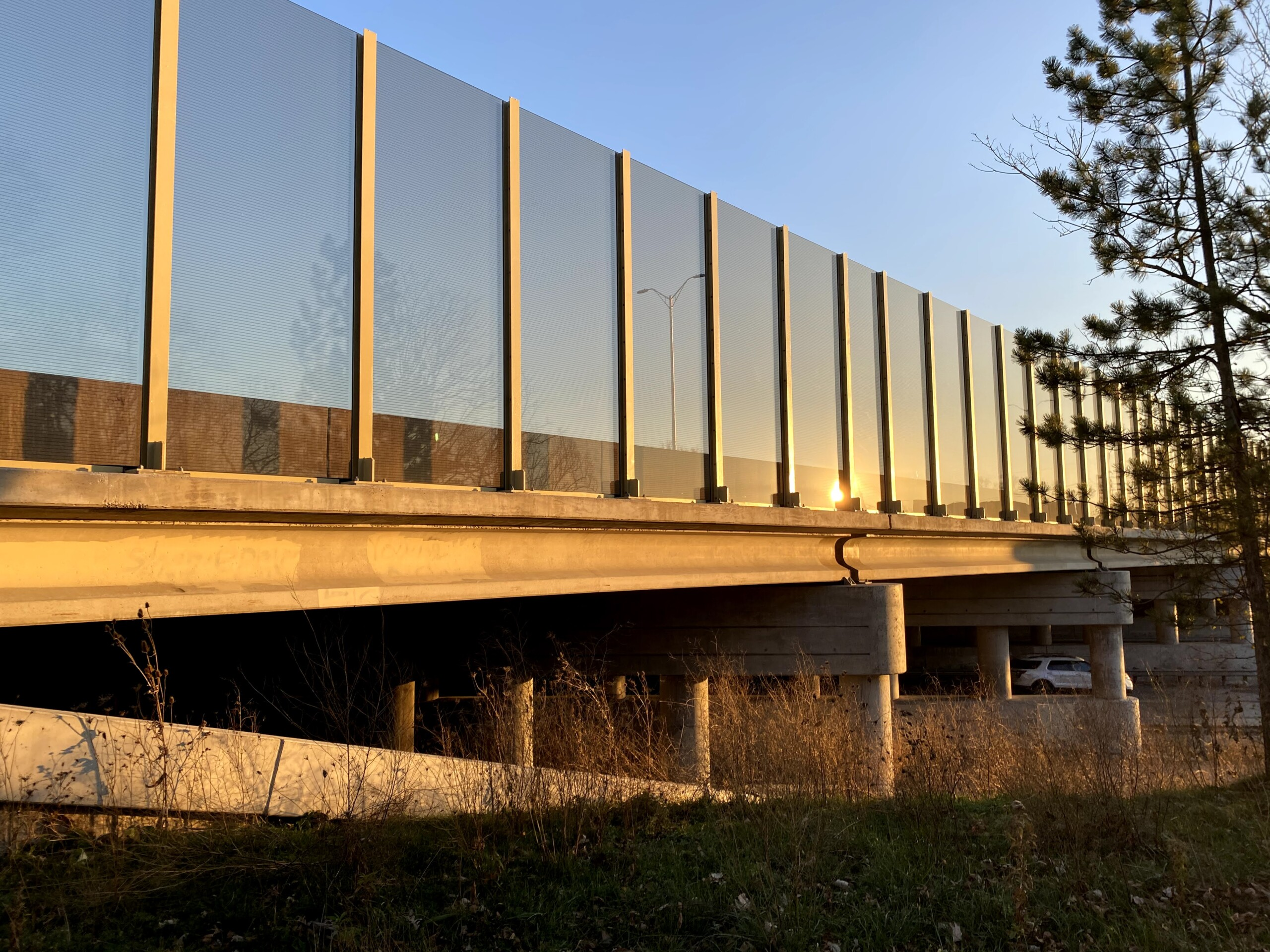 Transparent noise barrier panels with Bird Guard installed on a bridge on the Reagan Memorial Highway (I-88) in Elmhurst, IL.