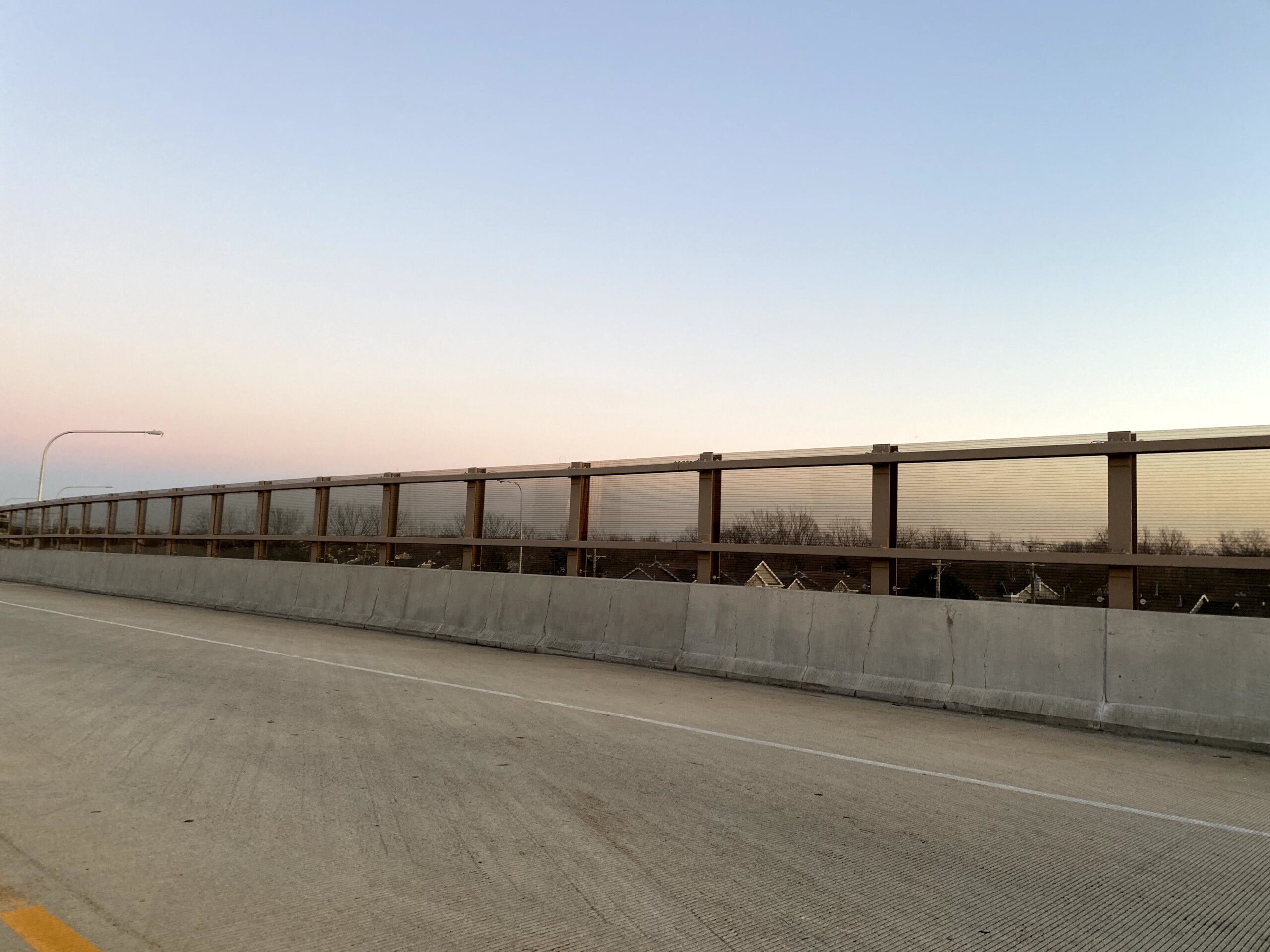 Acrylite Soundstop MASH TL-4 system mounted on a bridge along Illinois Route 390 in Itasca, Illinois.