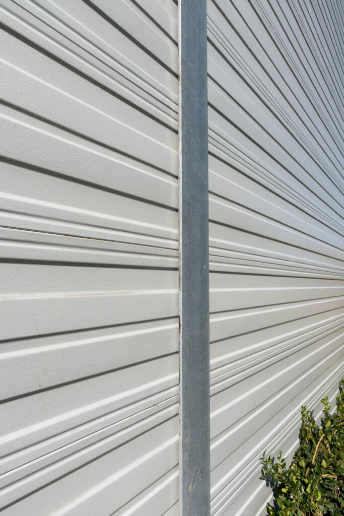 Aluminum noise wall at a distribution facility in California.